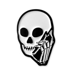 """<a href=""""https://instagram.com/skullphone/"""" target=""""_blank"""">Skullphone</a> x Revere Company Dyed Black Soft Enamel Lapel Pin Rubber Pin Backing 1"""" x .7"""" Die cut  <a href=""""http://reverecompany.com/products/14325072-skullphone-patch"""">Purchase the matching patch here</a>"""