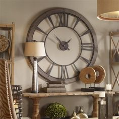 "06084 Ronan Large Wall Clock Oversized wall clock features a dark, rustic bronze finish accented with a rust gray frame. Requires one ""AA"" battery. Large Metal Wall Clock, Big Wall Clocks, Large Clock, Giant Wall Clock, Large Decorative Wall Clocks, Wall Clock Above Fireplace, Wall Clock Decor, Kitchen Wall Clocks, Rustic Mirrors"
