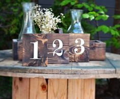 Gorgeous wood block table numbers - perfect for a rustic wedding theme!
