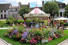 Carousel in Beaune (Burgundy) http://destinationfiction.blogspot.ca/2013/04/g-is-for-garden.html