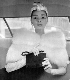 Jacky Mazel wearing capelet by Weill and hat by Gilbert Orcel, 1956. Photograph by Guy Arsac.