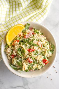 Tuna spinach salad with tomatoes and mozzarella is a light, fresh and healthy lunch! Serve it as a salad, in a wrap, with crackers or as an open-faced melt.
