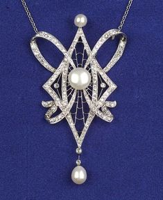 Art Nouveau Platinum & Diamond Pendant Necklace, ca 1925, bead & bezel-set throughout with single & old European-cut diamonds, approx total wt 1.40 cts. with later freshwater pearl accents, suspended from a later 14kt gold trace link chain, lg. 16 3/4 in.