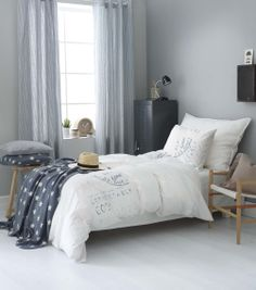 Scandinavian style bedroom with a vintage touch in grey, white, and wood by Princess Interior