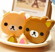 Choose a correction tape in Rilakkuma (brown) or Korilakkuma (beige). This correction tape is in your traditional 'white out' color and boasts a cute little bear face. This correction tape measures 2.