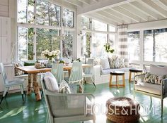 Think beyond the walls when it comes to using bold color in a cottage. In the open-concept living room of designer Sarah Richardson's rental cottage, she coated the floor in a gorgeous high-gloss turquoise that resembles beach glass. Sarah Richardson, Inexpensive Furniture, Outdoor Furniture Sets, Lac Huron, Salons Cottage, Modern Lake House, Slider, Cottage Living Rooms, Design Case
