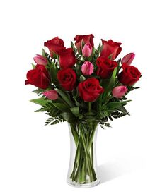 This Valentine's Day show your affections with The Secret Love Bouquet from Grower Direct. Contains red roses and hot pink tulips.