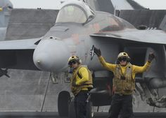 GULF OF OMAN (June 13, 2013) – An aviation boatswain's mate (handling) directs an F/A-18E Super Hornet assigned to the Argonauts of Strike Fighter Squadron (VFA) 147 into position to launch from the flight deck of the aircraft carrier USS Nimitz (CVN 68) in support of Operation Enduring Freedom. Nimitz Strike Group is deployed to the U.S. 5th Fleet area of responsibility conducting maritime security operations and theater security cooperation efforts.