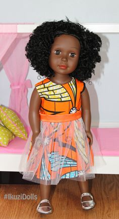 This Beautiful Black 18 Doll comes in a beautifully designed African print dress. It also comes with a pink carrying case perfect for the little girl on the go. Ikuzi Dolls are beautiful black dolls that come in different shades of brown. This is the dark skin brown Ikuzi Doll. Made by ZByOzi Designer Ozi Includes Doll & pink doll carrying case Doll Dress Same style but you have a choice of light purple, dark purple or orange print fabric. Doll details Vinyl head and limbs Huggable Cloth ...