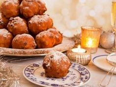 Oliebollen : <p>It's a holiday tradition in the <b>Netherlands </b>to eat oliebollen, a fritter-like doughnut filled with a mixture of raisins, currants, apples and lemon.</p> <p> </p> <p><i>Photo courtesy of Sara Winter via iStock</i></p>