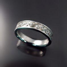 Unique, custom designed sculptural wedding band with diamonds. Inspired by client's tattoo! by www.zorandesigns.com