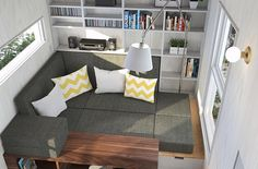 I want the couch to be a lounge area. I never sit on the couch with my legs down. I also want it to be a makeshift bed. ATELIER PRAXIS I Service de design d'intérieur   TINY HOUSE