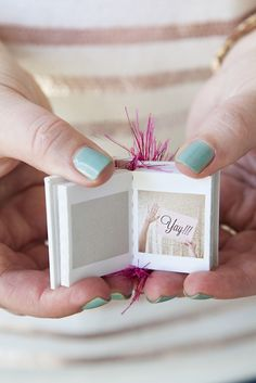 Mini flip book with photos. 10 Ways to Ask: Will You Be My Bridesmaid? on @intimatewedding #bridesmaidgifts #bridesmaid