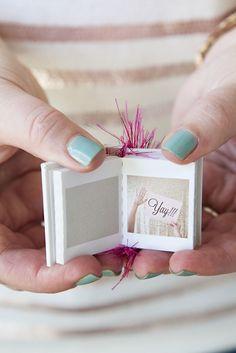 Mini flip book with photos. 10 Ways to Ask: Will You Be My Bridesmaid? on @intimatewedding #bridesmaidgifts #bridesmaid
