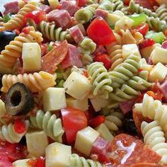 This Awesome Pasta Salad! has cherry tomatoes, provolone cheese, salami, pepperoni, bell peppers, black olives, pimentos and Italian dressing. Enjoy!