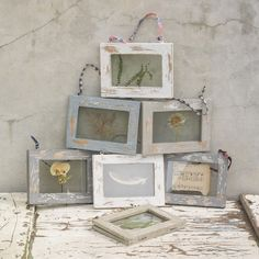 Bantu Hanging Frames || Beautiful distressed wooden hanging frame. Perfect for displaying treasured memories from old ticket stubs, to vintage family photographs. Each frame has a rustic, worn feel and is lovingly hung with coloured fabric from a traditional sari.