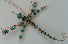 Copper wirework dragonfly suncatcher with millefiori glass and crystals