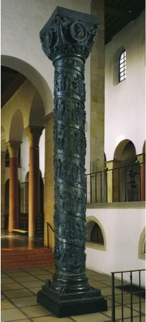 "[The Bernward Column, commissioned by Bishop Bernward for Saint Michael's, Hildesheim, Germany, ca. 1015–1022. Bronze, 12' 6"" tall. Dom-Museum.] This column is placed in the rear of the Church in the southern transept. It has seven spiral bands of relief which tells the story of Jesus' life from his baptism to his entry into Jerusalem. There are 24 scenes in total and it is read from the bottom to top. The flow of reading means an ascent to the 'pure and infinite space' of Heaven.(Kleiner…"