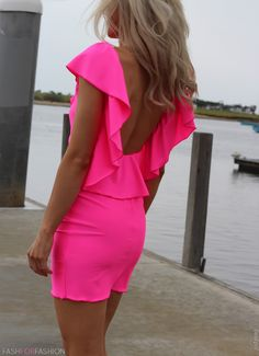 This could be just bright pink but it looks neon to me. Great dress that will catch the eye