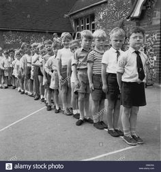Group of young children form a line outside in the playground of a small village primary school Nostalgic Images, London History, Vintage School, School Photos, My Childhood Memories, The Good Old Days, Primary School, Historical Photos, The Past