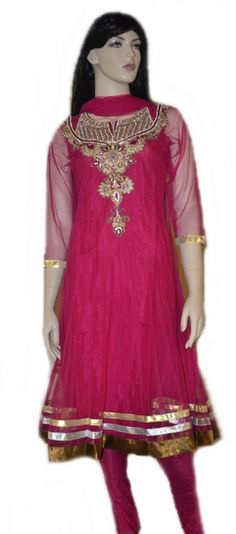This deep Pink  readymade net churidar Anarkali style kameez is adorned with  stones, zari, patch patti, sequins work. Matching churidar and attractive dupatta comes along with it. Slight variation in color and patch patti is possible. This Anarkali has net sleeves but short sleeves are also provided with the suit that can be stitched on if desired.