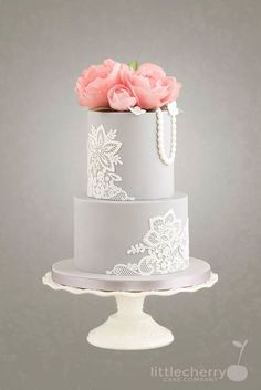Beautiful grey wedding cake lace and flowers - For all your cake lace decorating supplies, please visit http://www.craftcompany.co.uk/equipment/cake-lace.html