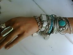 Silver and turquoise stacks.