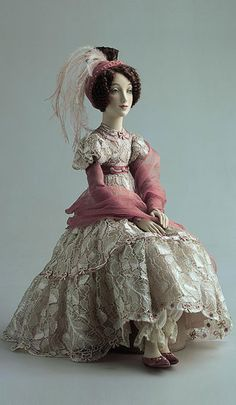 Kler doll by Alexandra Koukinova  Biscuit porcelain.   Natural atlas, crepe de chine, lacy cloth, chiffon, laces. Ostrich feathers. Shoes with hand embroidery. Hair - real mohair. Hand painting.