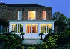 This design demonstrates how an orangery can maintain a traditional look without the use of brick and stone.