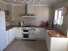 White Kitchen With Wooden Worktops white kitchen with oak worktop - do you think it looks better with