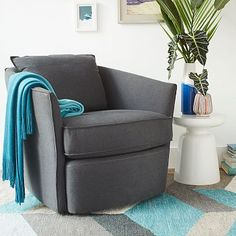 I like the gray-blue-charcoal-white combination. The pop of bright blue is also nice.   Duffield Swivel Chair - Solid #westelm