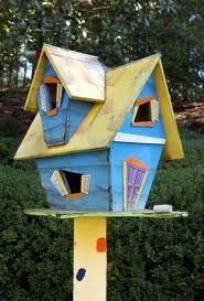 I have one of these but it has a red shingle roof and even more crazy stuff. I love it!