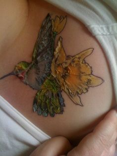 Hummingbird and daffodil tattoo.too bad the inked person isn't taking care of their piece. Your tattoo should NEVER look like this. All Tattoos, Tatoos, Fashion Tattoos, Daffodil Tattoo, Hummingbird Tattoo, Fitness Tattoos, Chest Tattoo, Beautiful Tattoos, Daffodils