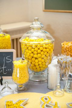 yellow party table (cute idea to fill cookie cutters with candy as decor)