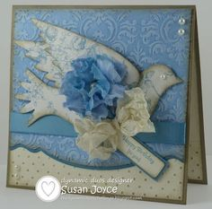 SU Card. Stamps: Under the Big Top.  Cardstock/Papers:Crumb Cake, Very Vanilla, Bashful Blue, Marina Mist, Beau Chateau DSP. Ink: Bashful Blue, Marina Mist, Crumb Cake. EB Folders: Provo Craft Jamara, SU Polka Dot. SU Dies: Adorning Accents Edgelits, Elegant Bird, Sizzlits Lots of Tags Label. Blossom Punch. Stamp-a-ma-jig, Sponges, Pearls, Crinoline Fabric, Marina Mist Satin Ribbon, Very Vanilla Ribbon Seam Binding, Bow Easy, Water Mister, Mini Glue dots, Dble Sided tape, Dimensionals.