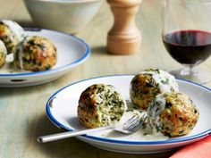 Rachael Ray's Florentine Meatballs - These spinach-flecked turkey meatballs are doused in a creamy provolone sauce that's so good you'll be splitting time with red on the regular. http://www.foodnetwork.com/recipes/rachael-ray/florentine-meatballs-recipe