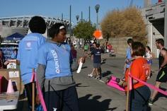 Xavier Women's Basketball volunteering at breast cancer 5K fundraiser.