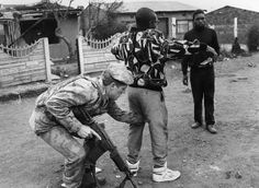 A resident of Tokoza is searched during operations by the SADF (South African Defense Force) and the police to quell the violence there--August Tokoza, South Africa Photo credit: Paul Velasco; Wall Prints, Poster Prints, Injustices In The World, Famous African Americans, Africa People, Lest We Forget, Mountain Man, African History, Black History Month
