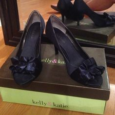 Kelly & Katie Navy Satin Heels Size 6 A great pair of festive heels, open toe. Navy compliments all colors and outfits. For instance I wore these with a deep purple bridesmaid dress! Good condition, worn once, in original box. Size 6. Kelly & Katie Shoes Heels