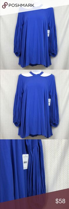 Free People Halter Long Sleeve Tunic Dress Free People Halter Long Sleeve Tunic Dress  Color: Royal blue Size XS Armpit to armpit- 21 in Waist- 29 Length- 32 Same day or next day shipping   Thank you for checking out my closet!!! Offers and questions are always welcomed Free People Dresses Long Sleeve