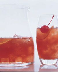 Sangria Rosada  One 750-ml bottle dry rosé wine  4 ounces brandy  2 ounces maraschino liqueur  3 ounces guava nectar or juice  ice  8 ounces chilled ginger ale  8 orange wheels  8 maraschino cherries