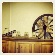 I like the idea of a small wagon wheel on top of the cabinets.