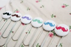 Cross stitched moustache bookmarks