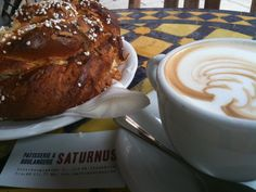 At Saturnus cafe, Stockholm: Humongous Cardamom rolls and lattes - one of their specialities.