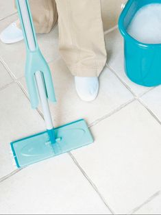 cleaning ceramic tile floors beautiful pastel blue mopping tools mopping water bucket