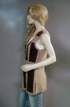 Vintage 70's boho suede long patchwork vest.... In classic hippie chic style, this knit & crocheted vest sports rectangles of chocolate brown suede. Its long and a bit fitted at the waist. I love the open crochet work! The vest buttons in front with round, yarn covered buttons.