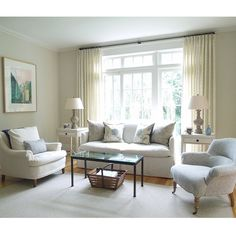 Happy Thursday :) Here's a peek of a living room project. Curtains just installed. Walls painted Benjamin Moore Plaster of Paris. Sofa from Lee. White club chair is vintage. Antique coffee table from my shop. #toneontoneantiques