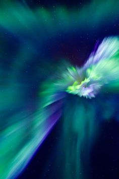 Few auroras show this level of detail standard digital camera captured the active colorful auroral corona with a shape reminiscent of a flower,the spectacular aurora had unusually high degree detail.The vivid green auroral colors are caused by high atmospheric oxygen reacting to burst of incoming electrons.Many photogenic auroras have triggered from a solar wind stream that recently passed the Earth.