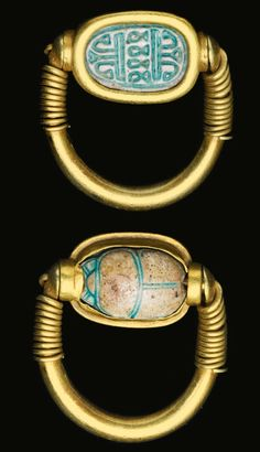 CARAB SWIVEL RING, EARLY 18TH DYNASTY, 1540-1400 B.C. with solid gold hoop, the spiral wire wound around the shoulders and through the convex terminals and turquoise-glazed scarab, the scarab carved underneath with a decorative device composed of stylized lotus and papyri.