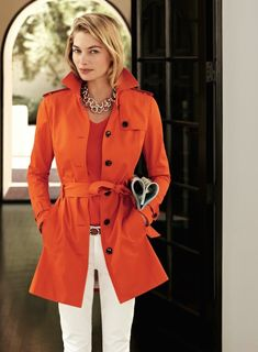 Add some style to your trench coat collection with one of these 13 colorful Spring trench coats or choose a patterned trench coat to jazz up your wardrobe   OMG Lifestyle Blog   Orange Trench Coat with White Pants